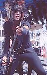 Nikki Sixx of Motley Crue  at Castle Donnington , England Aug 1984 Donnington Monsters of Rock 1984 Donnington 1984