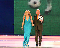 Franz Beckenbauer and Heidi Klum walk on stage at the final draw. The final draw for the 2006 FIFA World Cup took place in the Congress Centre in Leipzig, Germany on December 9 2005.