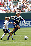 27 June 2004: Julie Fleeting (10) and Nel Fettig (left). The San Diego Spirit defeated the Carolina Courage 2-1 at the Home Depot Center in Carson, CA in Womens United Soccer Association soccer game featuring guest players from other teams.