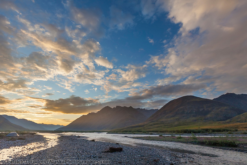 Midnight sunset over the Marsh Fork of the Canning river in the Arctic National Wildlife Refuge in the Brooks range mountains, Alaska.