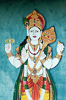 Painting of a Hindu deity at one of the many Hindu temples on the island.