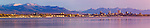 View of downtown Anchorage skyline across Knik Inlet, shot from the port at Point Mckensie. Kenai mountains in background. Summer, sunset, Anchorage Alaska.