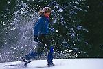 Woman snowshoeing at Castle Peak