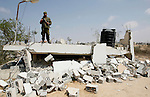 Palestinian security forces inspect security headquarters destroyed during fighting between Hamas militants and Israel on the border between Egypt and Gaza in Rafah, southern Gaza Strip in August 31, 2014. An indefinite ceasefire to end seven weeks of fighting between Israel and Palestinian militant groups in the Gaza Strip was holding with Hamas declaring 'victory' and the Israeli cabinet divided on the deal. Egypt, which brokered the deal, has said that indirect talks between the two sides would resume within a month. More than 2,130 Palestinians and 70 Israelis, mainly soldiers, have been killed in 50 days of fighting. Photo by Abed Rahim Khatib