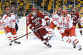 Adam Clendening (BU - 4), David Valek (Harvard - 22), Garrett Noonan (BU - 13), Ross Gaudet (BU - 22), Marshall Everson (Harvard - 21) - The Harvard University Crimson defeated the Boston University Terriers 5-4 in the 2011 Beanpot consolation game on Monday, February 14, 2011, at TD Garden in Boston, Massachusetts.