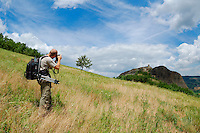 A photographer in the beautiful scenario of the Apennines, Italy.