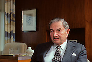 New York, NY. November 1985. American millionaire David Rockefeller in his New York office. The former President of Chase Manhattan Bank, David Rockefeller, heads the family empire, founded at the beginning of the 20th century by John D. Rockefeller.