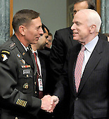 Washington, DC - April 8, 2008 -- General David Petraeus, left, shakes hands with United States Senator John McCain (Republican of Arizona), right as he and Ambassador Ryan Crocker (not pictured) arrive to testify before the United States Senate Armed Services Committee on the situation and progress in Iraq in Washington, D.C. on Tuesday, April 8, 2008..Credit: Ron Sachs / CNP