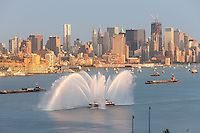 """WEEHAWKEN, NJ - JULY 4: FDNY fire boat Marine 1 """"Three Forty Three"""" puts on a water show on the Hudson river prior to the annual Macy's Fourth of July fireworks on Monday, July 4, 2011."""