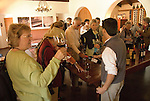 Chile Wine Country: Tasting wine at Undurraga Winery, Vina Undurraga, near Santiago. .Photo #: ch443-32845.Photo copyright Lee Foster, 510-549-2202, www.fostertravel.com, lee@fostertravel.com.