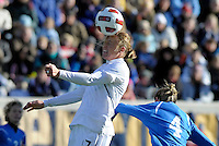 US forward Abby Wambach (17) heads the ball in front of Italian midfielder Alessia Tuttino (4).  The U.S. Women's National Team defeated Italy 1-0 at Toyota Park in Bridgeview, IL on November 27, 2010 to advance to the Women's World Cup in Germany.