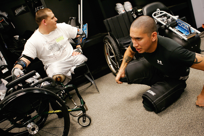 Two Rampage sled hockey team players suit up before a game, Feb. 23, 2007, at the AT&T Center, San Antonio, Texas. (Darren Abate/pressphotointl.com)