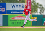 11 March 2013: Washington Nationals outfielder Tyler Moore rounds the bases after hitting a solo home run during a Spring Training game against the Atlanta Braves at Space Coast Stadium in Viera, Florida. The Braves defeated the Nationals 7-2 in Grapefruit League play. Mandatory Credit: Ed Wolfstein Photo *** RAW (NEF) Image File Available ***