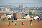 SOWETO, SOUTH AFRICA - SEPTEMBER 14: Unidentified boys play soccer during a practice on September 14, 2007 in the Diepkloof section Soweto, South Africa. Soccer is the most popular sport in South Africa, and a because of the upcoming World Cup 2010 in South Africa the interest is increasing. For the first time the World Cup will be held on the African continent. South Africa doesn't have an organized youth soccer program and many teams and players struggle with lack of funds to buy equipment and money for transport to games. .(Photo by Per-Anders Pettersson)..