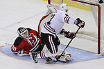 Mar 27; Newark, NJ, USA; New Jersey Devils goalie Martin Brodeur (30) makes a save on Chicago Blackhawks right wing Marian Hossa (81) during the overtime shootout at the Prudential Center. The Devils defeated the Blackhawks 2-1.