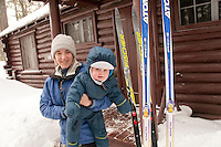 A mother and child at the Keweenaw Mountain Lodge in Copper Harbor Michigan in winter.