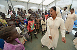 Sister Ranjitha Maria Soosai, a member of the Daughters of Mary Immaculate, leads a group of children in singing inside a camp for internally displaced families inside a United Nations base in Juba, South Sudan. The camp holds more than 20,000 Nuer who took refuge there in December 2013 after a political dispute within the country's ruling party quickly fractured the young nation along ethnic and tribal lines. Ten DMI sisters from India work in the camp, providing counseling and psycho-social support for women and children, teaching children in makeshift schools, and providing food to hungry families.