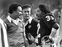 Oakland Raiders sideline chat: Willie Brown, Coach Tom Flores, and Jack Tatum. (1979 photo/Ron Riesterer)
