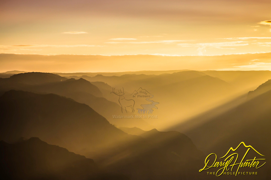The light beams of sunrise at Waimea Canyon on the island of Kauai, Hawaii.  Waimea Canyon is known as the Grand Canyon of the Pacific and truly is grand.