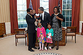 Lauren Fleming, the 2011 March of Dimes National Ambassador, looks up as her brother Corbin touches United States President Barack Obama's face during a visit to the Oval Office, February 7, 2012. Lauren is also accompanied by her parents Densel and Nikki Fleming, and her sister Erin..Mandatory Credit: Pete Souza - White House via CNP