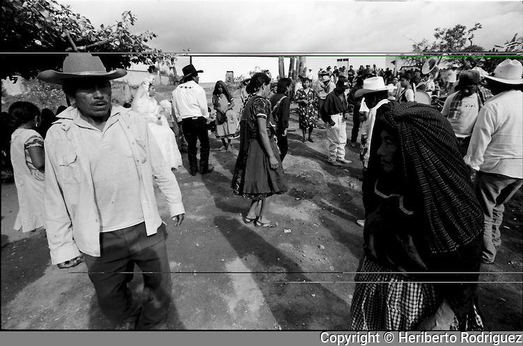 A Zapotec Native newly-married couple dances as musicians play traditional dances during the wedding ceremony in Coatecas Altas village, Oaxaca, November 22, 1998. Most of the villagers of Coatecas leave their home to harvest in northern state of Sinaloa.  © Photo by Heriberto Rodriguez