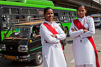 Ekta aged 28 (left) and Mamta (right) aged 26 on the streets of Delhi on 30th March 2010.<br /> These female drivers were part of a program by Azad Foundation.<br /> Currently training their 4th batch of students, Azad Foundation was set up by Meenu Vadera (Executive Director) in New Delhi, India, to train Indian women in driving services. Upon completion, these women work as personal drivers for a period of time before they upgrade their driving licences to commercial licences, allowing them to drive taxis. With this program, Azad aims to empower Indian women including those previously abused or trafficked, while making Delhi a safer place for women travelling in public transport. Photo by Suzanne Lee for Panos London