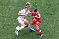 June 21, 2015: Ana Maria CRNOGORCEVIC of Switzerland and Desiree SCOTT of Canada fight for the ball during a round of 16 match between Canada and Switzerland at the FIFA Women's World Cup Canada 2015 at BC Place Stadium on 21 June 2015 in Vancouver, Canada. Canada won 1-0. Sydney Low/Asteriskimages.com