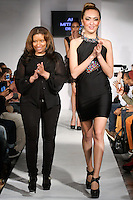 Fashion designer Ann Mitchell, walks runway with model at the close of her Ann Mitchell Design Little Black Dress Collection fashion show,  during BK Fashion Weekend Fall Winter 2012.