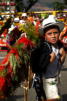 """A boy attends the traditional """"Silletero"""" parade during the Flower Festival in Medellin August 7, 2012. Photo by Eduardo Munoz Alvarez / VIEW."""