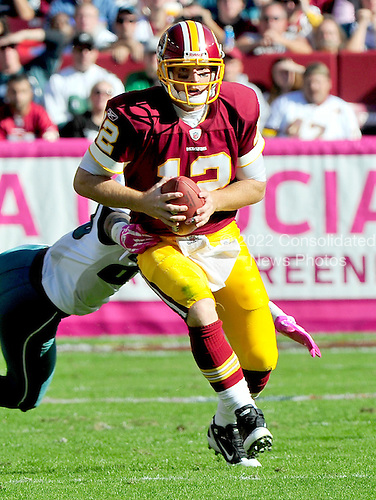 Washington Redskins quarterback John Beck (12) scrambles in the fourth quarter against the Philadelphia Eagles at FedEx Field in Landover, Maryland on Sunday, October 16, 2011.  The Eagles won the game 20 - 13..Credit: Ron Sachs / CNP