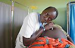 Marieta Carlo, a midwife, listens to Susan Peter's abdomen at the St. Daniel Comboni Catholic Hospital in Wau, South Sudan.