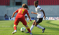Nikita Parris of England battles the Ellen Rose Curson of Wales during the UEFA Womens U19 Championships at Parc y Scarlets, Monday 19th August 2013. All images are the copyright of Jeff Thomas Photography-www.jaypics.photoshelter.com-07837 386244-Any use of images must be authorised by the copyright owner.