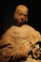 Sculpture of a woman, 1530-34, in terracotta, from the Last Supper sculptural group by Philip Hodart made in Renaissance Mannerist style for the refectory of the monastery of Santa Cruz in Coimbra, in the Museu Nacional de Machado de Castro, Coimbra, Portugal. The museum was opened in 1913 and renovated 2004-2012. The city of Coimbra dates back to Roman times and was the capital of Portugal from 1131 to 1255. Its historic buildings are listed as a UNESCO World Heritage Site. Picture by Manuel Cohen