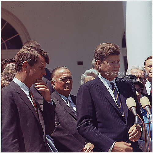 Washington, DC -- Presentation of the Young American Medals for Bravery in the Rose Garden at the White House  in Washington, DC on May 7, 1963.  Left to right: U.S.  Attorney General Robert F. Kennedy;  Director of F.B.I. J. Edgar Hoover;  U.S. President John F. Kennedy. <br /> Credit: White House via CNP