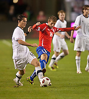 CARSON, CA – JANUARY 22: USA defender Zach Loyd (12) and Chile Felipe Seymour (14) during the international friendly match between USA and Chile at the Home Depot Center, January 22, 2011 in Carson, California. Final score USA 1, Chile 1.