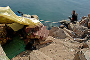 A young Moroccan lives in an improvised one-man shack built near the port of Tanger, Morocco, 21 January 2007. Every day tens of Moroccan young men try to cross ilegally the Strait of Gibraltar. ?Harraga? (immigrants in Arabic) come to Tanger from all over Morocco. They try their good luck and hidden between the wheels of a truck they attempt to board on a ferry and get to Spain, eventually further to Europe. Considering the thorough checks at the port only few of them make it. Therefore they spend months living on a beach, in huts along the walls of the port, begging for food and waiting for the right night so as their dream about Europe came true.