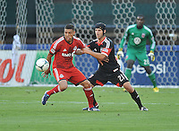 Luis Silva (11) of Toronto FC goes against Kris Korb (22) of D.C. United.  FC. Toronto FC defeated D.C. United 2-1, at RFK Stadium, Saturday June 15 , 2013.