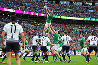 Jordi Murphy of Ireland wins the ball at a lineout. Rugby World Cup Pool D match between Ireland and Romania on September 27, 2015 at Wembley Stadium in London, England. Photo by: Patrick Khachfe / Onside Images
