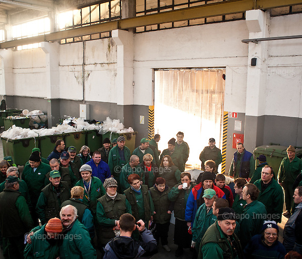 Warsaw, Poland, November 2011:.Employees of Ekon Association posing for a photo at the recycling facility. .Ekon Association in Warsaw is a recycling plant that provides jobs for people with learning difficulties or mental health issues; who would otherwise find it difficult to get work. .(Photo by Piotr Malecki / Napo Images)..Warszawa, Listopad 2011:.Pracownicy stowarzyszenia Ekon w sortowni odpadow..Ekon zajmuje sie recyklingiem odpadow i zatrudnia ludzi uposledzonych, lub chorych psychicznie, ktorzy inaczej mieliby trudnosci ze znalezieniem pracy..Fot: Piotr Malecki / Napo Images.