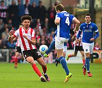 Lincoln City's Lee Angol vies for possession with Macclesfield Town's Neill Byrne<br /> <br /> Photographer Andrew Vaughan/CameraSport<br /> <br /> Vanarama National League - Lincoln City v Macclesfield Town - Saturday 22nd April 2017 - Sincil Bank - Lincoln<br /> <br /> World Copyright &copy; 2017 CameraSport. All rights reserved. 43 Linden Ave. Countesthorpe. Leicester. England. LE8 5PG - Tel: +44 (0) 116 277 4147 - admin@camerasport.com - www.camerasport.com