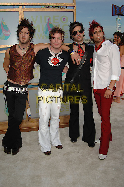 CHERRY MONROE.MTV Video Music Awards.Arrivals held at the American Airlines Arena,.Miami, 28th August 2005.full length band punk hair red spikey stud belt black .Ref: ADM/JW.www.capitalpictures.com.sales@capitalpictures.com.© Capital Pictures.v-neck plunging neckline