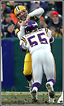 Green Bay's Brett Favre is sacked for a 10-yard loss by Minnesota's Chris Claiborne in the 1st quarter. .The Green Bay Packers hosted the Minnesota Vikings in a NFC Wildcard game Sunday January 9, 2005, at Lambeau Field in Green Bay, WI. WSJ/Steve Apps.