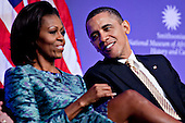 United States  President Barack Obama talks to First Lady Michele Obama at the groundbreaking ceremony of the Smithsonian National Museum of African American History and Culture in Washington, D.C. on Wednesday, February 22, 2012. The museum is scheduled to open in 2015 and will be the only national museum devoted exclusively to the documentation of African American life, art, history and culture. .Credit: Andrew Harrer / Pool via CNP