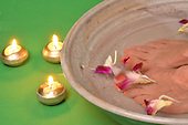 Stock photograph of feet and candles
