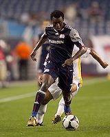 New England Revolution forward Kenny Mansally (7) challenged as he brings the ball forward. The New England Revolution defeated Monarcas Morelia in SuperLiga 2010 group stage match, 1-0, at Gillette Stadium on July 20, 2010.