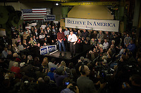 Former Massachusetts governor Mitt Romney speaks at a Romney campaign event to begin at Gilchrist Metal Fabricating in Hudson, New Hampshire, on Jan. 9, 2012.  Romney is seeking the 2012 Republican presidential nomination.