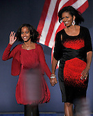 Chicago, IL - November 4, 2008 -- Malia Obama, left, and Michelle Obama, right, walk out on stage prior to United States President-elect Barak Obama speakng in Lower Hutchinson Field, Grant Park, Chicago, Illinois after his election as President of the United States on Tuesday, November 4, 2008..Credit: Ron Sachs / CNP.(Restriction: No New York Metro or other Newspapers within a 75 mile radius of New York City)