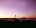32,824-01...WASHINGTON - 1965 photograph of a sunrise over Seattle and the Space Needle with Mount Rainier in the distance.