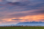 White haze hangs low on the horizon near the mountains at sunset in Western Montana.