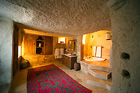 Goreme, Cappadocia, Turkey, July 2005. The bedroom stays cool in summer and warm in winter. Dutch Photographer Frits Meyst and his wife Jillian Macdonald restored an old rock house in the village of Goreme. Since Roman Times people have been cutting graves and home out of the Soft tufo 'Fairy Chimney' rocks of Cappadocia. Photo by Frits Meyst / MeystPhoto.com